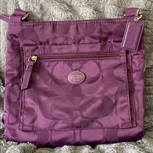 COACH purple nylon crossbody bag.